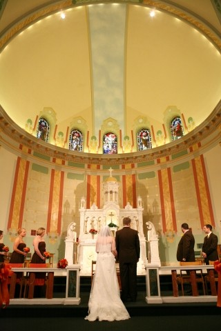 image of bride and groom at alter
