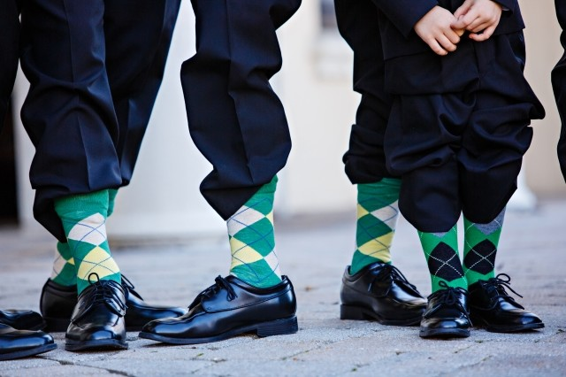 image of groomsmen with socks showing