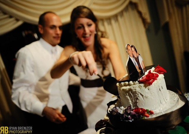 image of bride and groom cutting cake